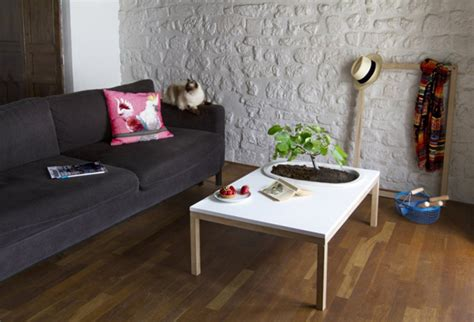 creative coffee tables featuring built  plant pot