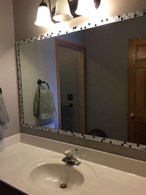 added strips  peel  stick tile  edge  mirror