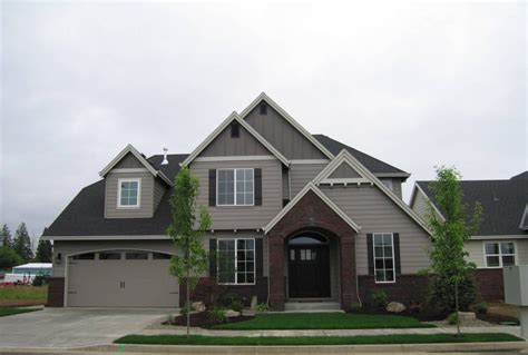 fantastic two story home with mixed siding and brick we
