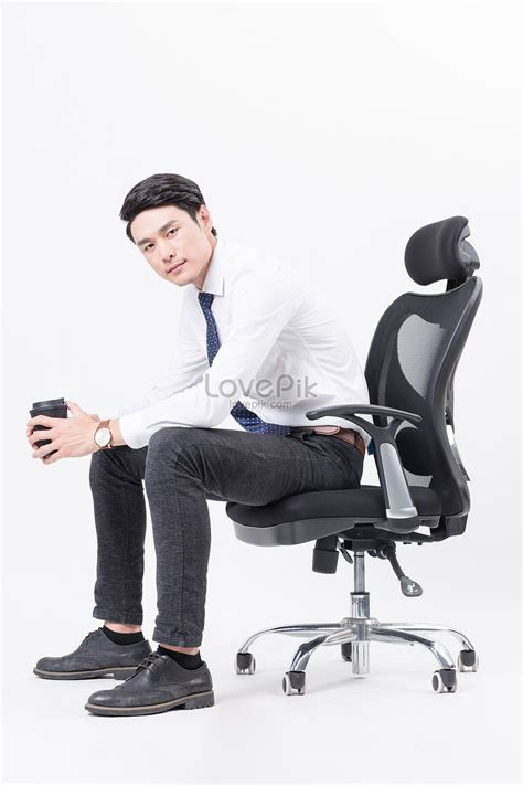 Sitting Chair by A Business Sitting In An Office Chair And