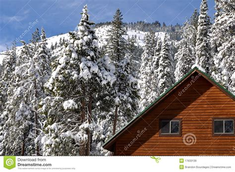 Winter Cabin With Snow Covered Roof Royalty Free Stock