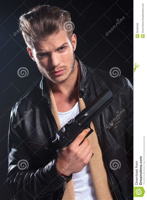 hitman  leather clothes holding  big gun   hand