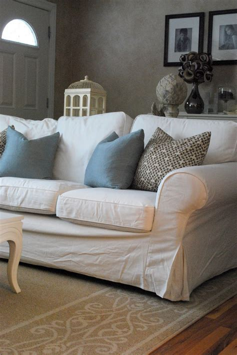 slipcovered settee comfortable white slipcovered sofa that brings
