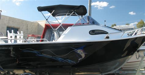 Should You Tow Your Boat With The Cover On by Trailer Boats Moored Boats