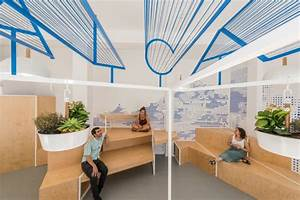 A modern tourist office in spain featuring cool graphic for Interior design tourism office