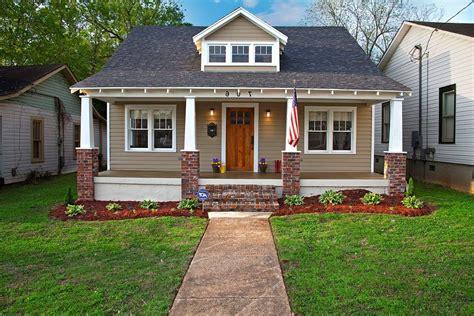 beige brick house exterior craftsman with red brick column