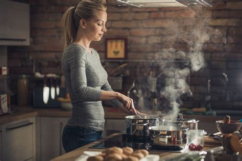cooking kitchen woman busy cookware young pan sets lunch thermador induction eating healthy tips choosing vent consider hood hobs istock