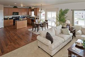 open floor plan kitchen family room wood floors With kitchen and family room design