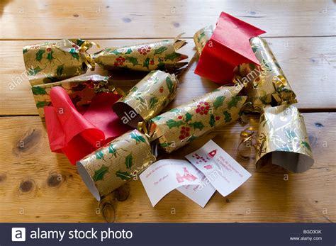 how to make christmas cracker hats crackers with paper hats and jokes stock photo royalty free image 27333059