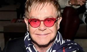 Elton John gives rare glimpse into family life to ...  Elton