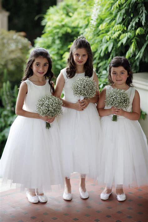flower girls  tulle skirted dresses carrying babys