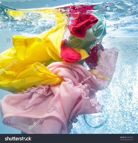 Colorful Clothes In The Washing Machine Stock Photo