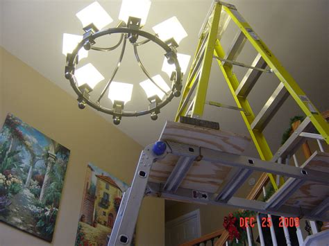 How To Clean Chandeliers On High Ceiling by Replacing Light Bulbs In High Ceilings Bindu Bhatia