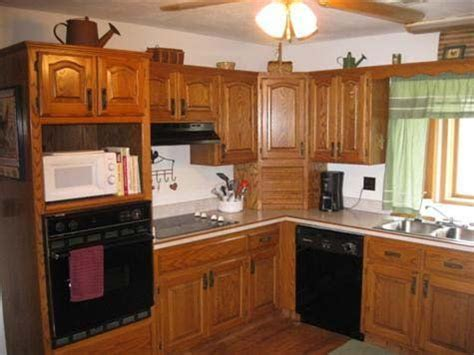 How To Update Oak Cabinets - how to update outdated oak kitchen cabinets questions