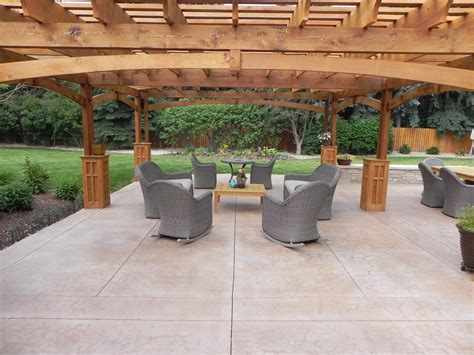 Stamped Concrete Patio Floor Design & Pattern With [10. Hanging Shelves From Ceiling. Yellow Kitchen. Covered Outdoor Kitchen. In Wall Toilet. Accent Tables. Sherwin Williams Killian Beige. Orange Side Table. Patio Fence Ideas