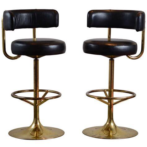 pair  vintage swivel brass bar stools