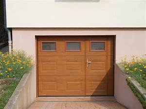 porte de garage traditionnelle imitation chene dore With porte de garage enroulable et porte bois massif prix