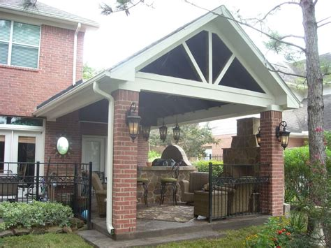 gable roof patio cover with outdoor kitchen fireplace texas custom patios