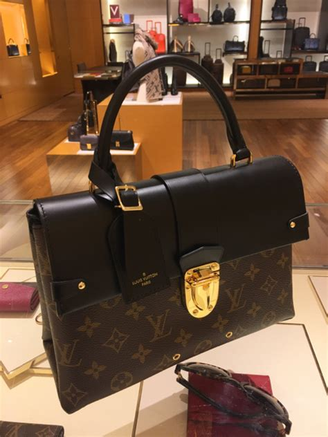 louis vuitton  handle flap bag reference guide spotted fashion