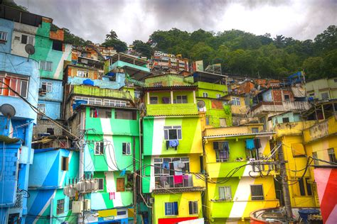 homes built into hillside slum paintings adding color to the culture ist