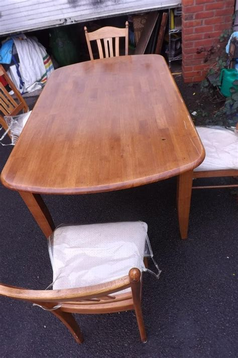 solid wood dining room table 4 matching chairs for sale