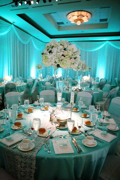 soft blue lighting with white blush and green