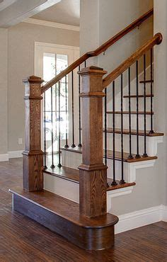 Bannister Custom Homes. Metal Balusters + Stained Banister