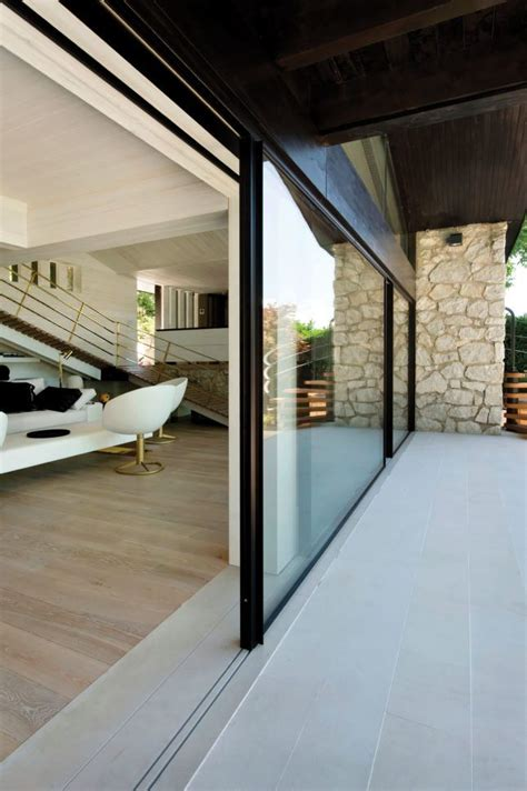 Invisible Doors Turn A Modern Home Into An Artistic Feat Of Design by These Exterior Walls Turn Residential Interiors Into Open