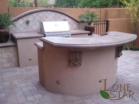 outdoor kitchen with separate bbq island with bar top