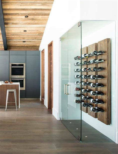 innovative wall mounted wine racks  dining room transitional  vitrine   glass front