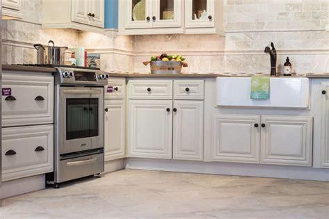 cabinets to go malibu white victoria ivory kitchen cabinets traditional kitchen