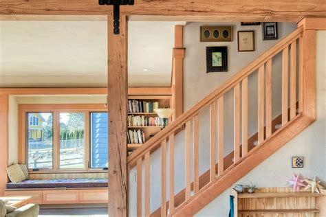 maple wood stairway  rustic exposed beam built  custom reading nook  bookcase
