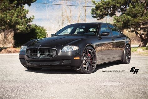 black maserati black maserati quattroporte with black pur wheels