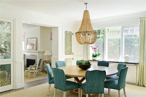blond dining table  peacock blue dining chairs