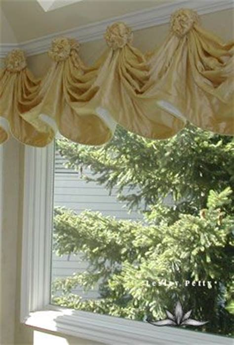 rosette valance on swags hung with rosettes window