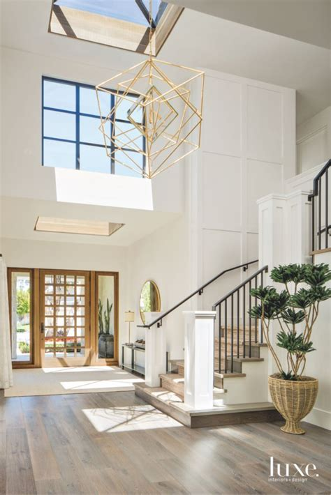 Geometric Light Chandelier Entryway with Staircase and