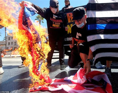 trump july flag burning american protests johnson donald gregory protesters gather protest right florida fourth joey lauderdale during president americans