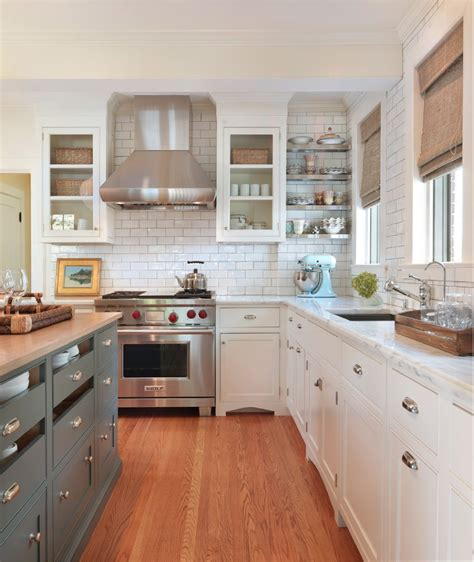 white kitchen with grey tiles white cabinets with silver clamshell pulls different 1838