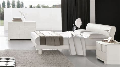Modern Grey Wooden Curve Shaped Couch On The Carpet Wall