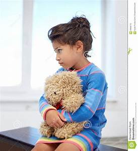 Sad Little Girl With Teddy Bear Toy At Home Stock Photo ...