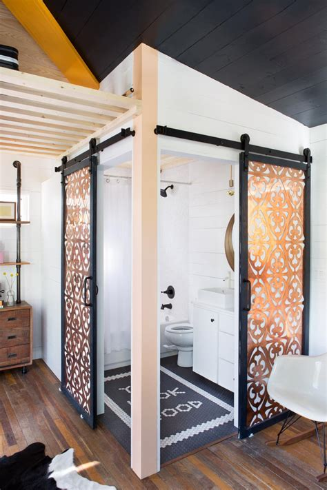 bathroom barn doors  copper panels hgtv