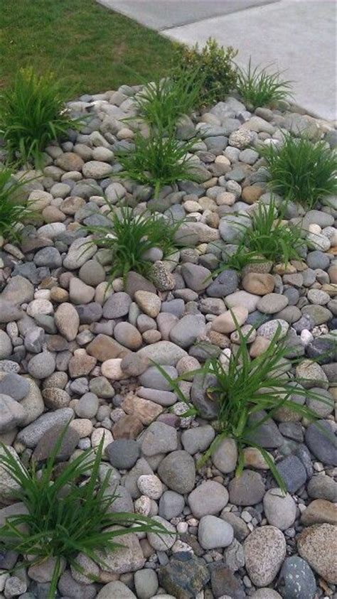 31 great ideas and pictures of river rock tiles for the river rocks front yard flowers and flower beds on