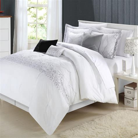 white and silver comforter minimalist bedroom with white