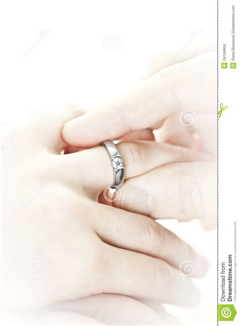 man putting engagement ring finger stock images image 24144904