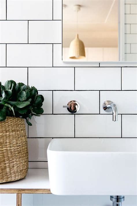 bathroom with white subway tiles and black grout modern
