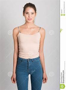 Blonde Girl Wearing Blue Jeans And T-shirt. Studio Shot Stock Image - Image of long body 48548677