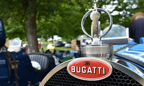 Bugatti recently released some information about its famous red and white radiator badge, and it's as for ettore bugatti's initials being black at the top of the badge, that represents excellence and. The Legendary Bugatti Crest - 110 Years And Counting