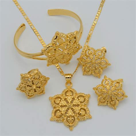 set kalung anting princess gold flowers set jewelry 22k gold plated pen