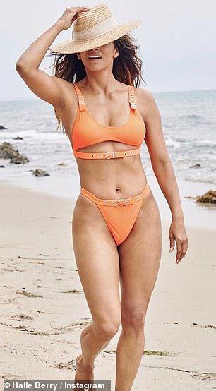 Halle Berry proves she's still a Bond beauty as she ...