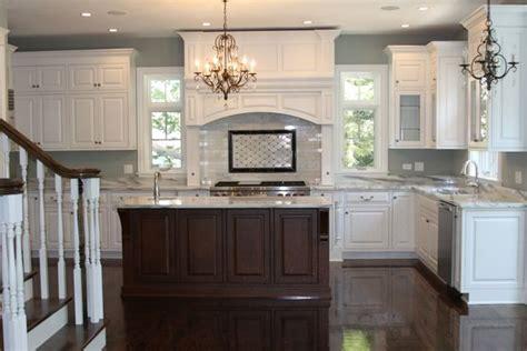 white kitchen brown island dark floors paint
